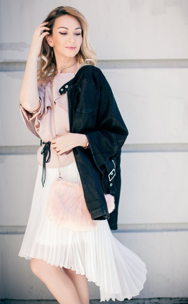 Blush cold shoulderpink satin top white pleated high low skirt black leather jacket and pink satin booties
