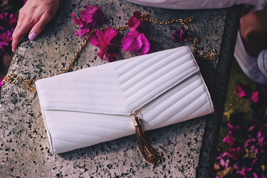 White quilted bag with gold tassel