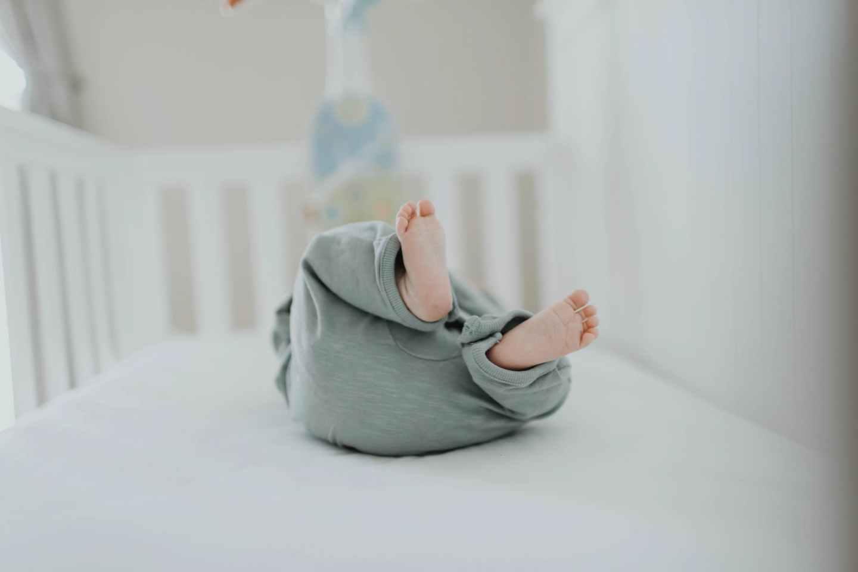 close up photo of baby wearing gray pants