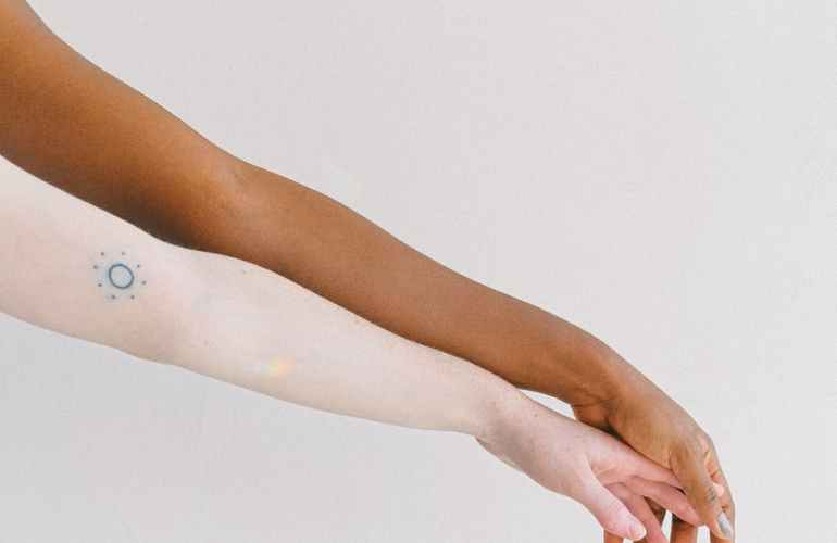 arms extended on white background
