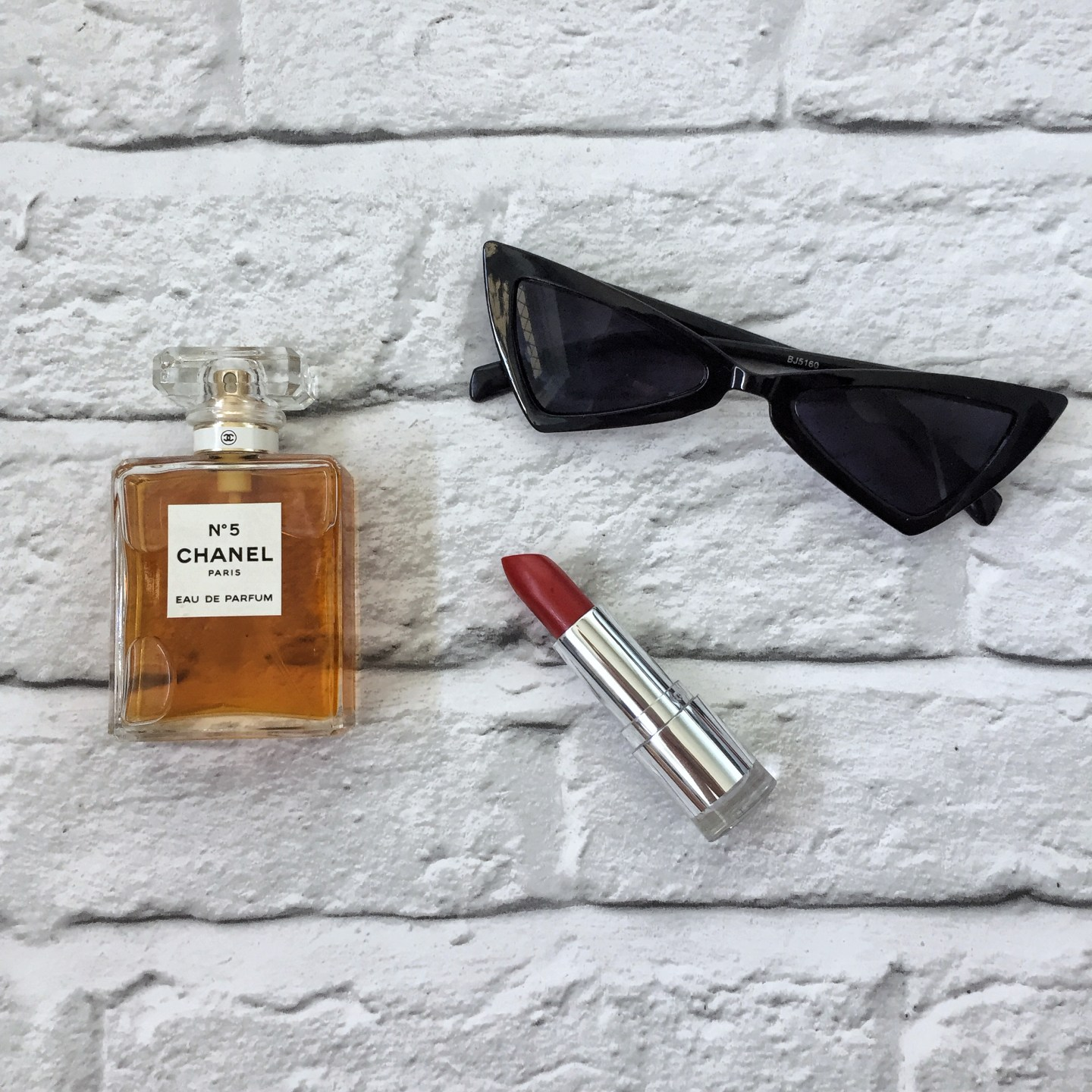 cat eye sunglasses, chanel perfume, red lipstick, ysl dupe sunglasses