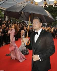 Leonardo-DiCaprio-using-an-umbrella-at-a-red-carpet-event