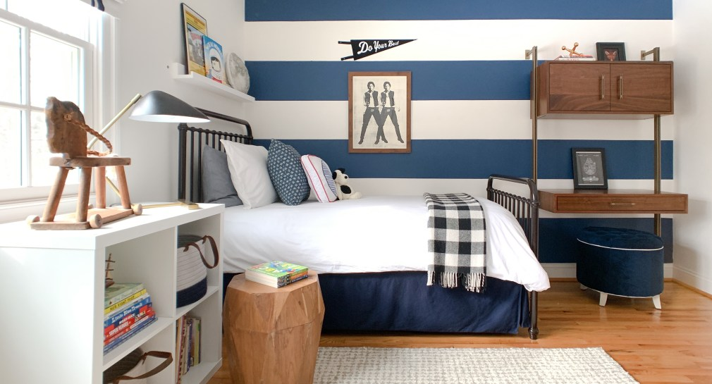 Styling Gypsy Interior Design | Classically Cool Boy's Room reveal featuring iron bed, wood wall desk, black plaid throw blanket, star wars art prints, blue storage baskets and ikea kallax shelves #boysroom #boysroomideas #boysroominspiration #starwarsbedroom #boysroomdecor #kidsroom
