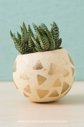 decorate-a-bell-cup-with-a-gold-paint-pen-to-make-a-cute-planter-for-succulents-585x878