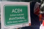 Poster; ACEH sudah dukung #Anti Miras, Kota Kamu Kapan???. (Foto: Ujang Komar)