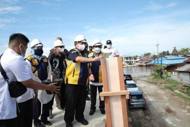 selamatan dimulainya pembangunan Jembatan HKSN 1 di tempat halaman parkir Makam Sultan Suriansyah