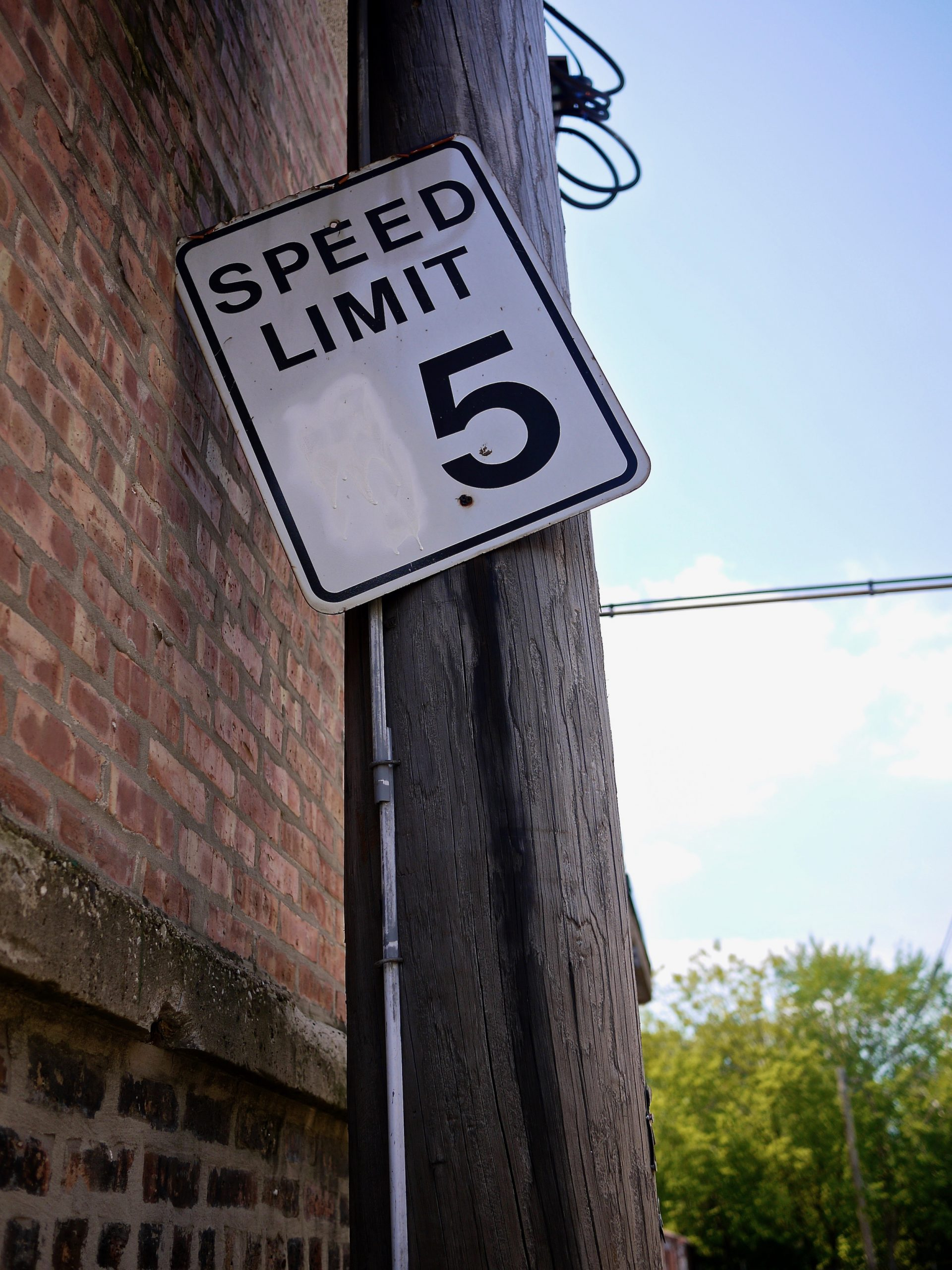 """A speed limit sign with the first number painted over leaving only a """"5"""""""