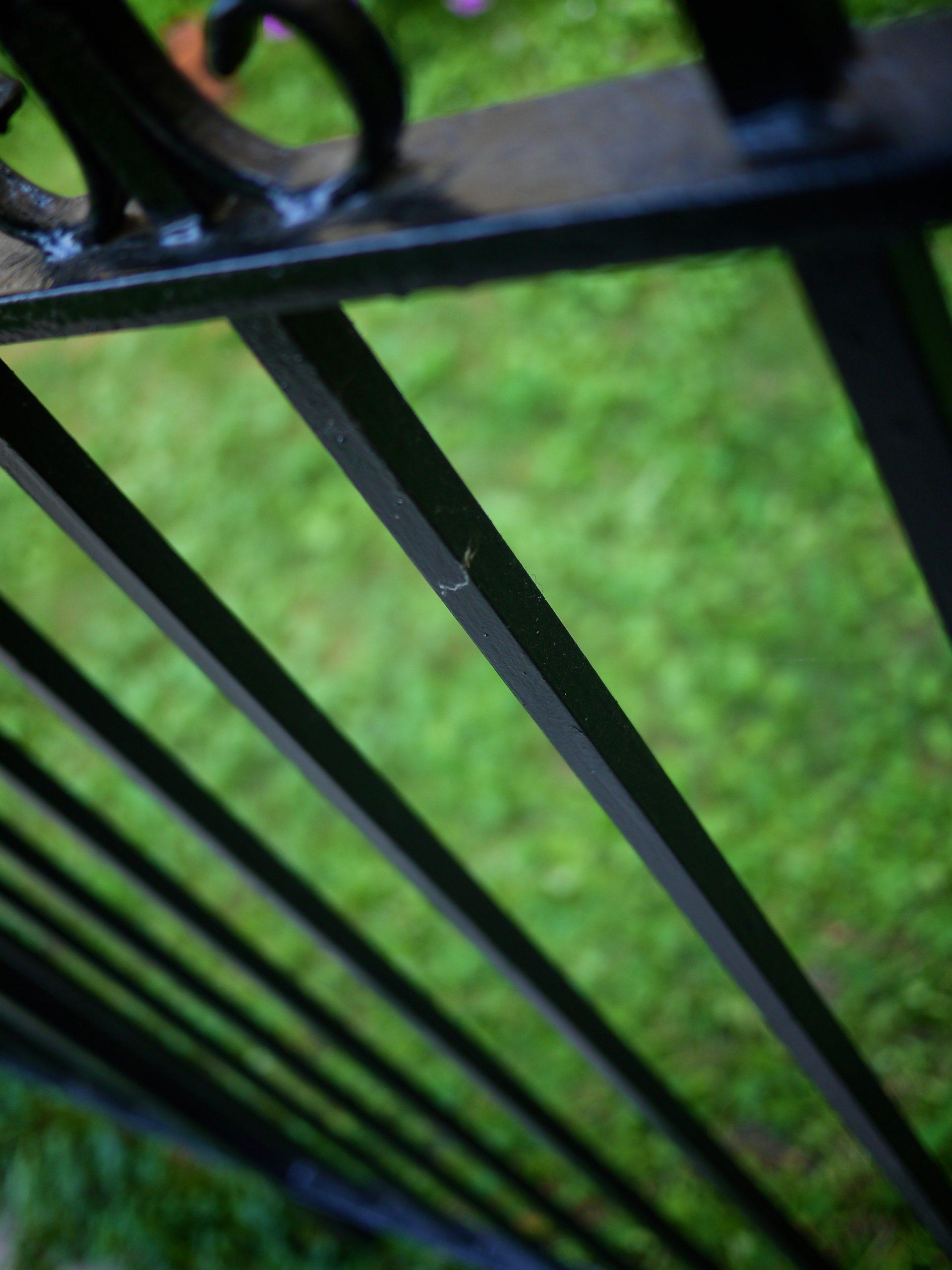 A high angle shot of an iron fence.