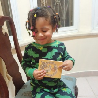 Jasmine holding her first hand made card.
