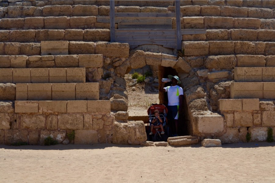 A quick pause for water and shade at Caesarea National Park, Israel