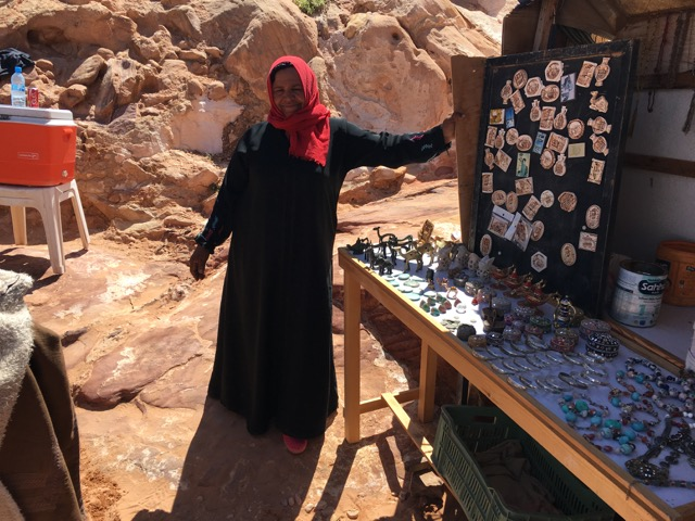 Travel with kids - Bedouin selling her wares on the way down in Petra