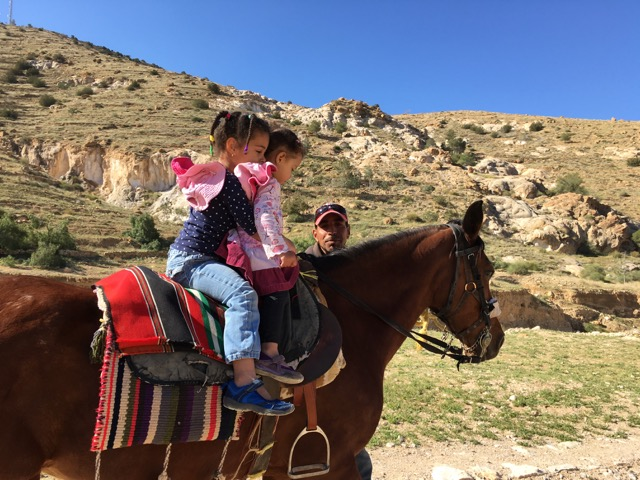 Travel with Kids - Jasmine and Grace on a horse at Peta