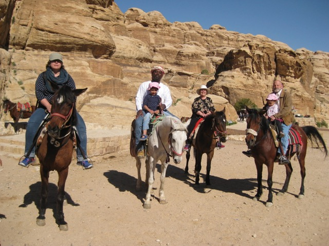 Travel with kids - The whole family on horses at Petra