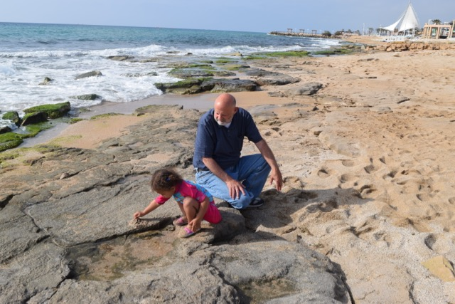 Travel with Kids - Dad and Grace at the beach in Nahariyya