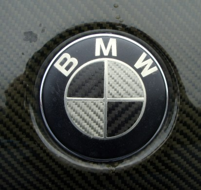 Carbon fiber badge on a 3-series with a carbon fiber bonnet.