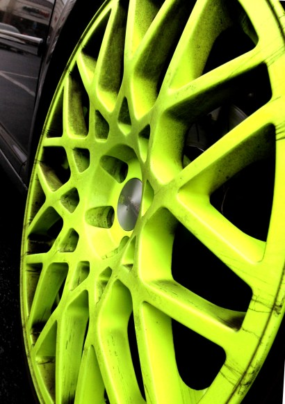 Hard-to-miss chartreuse wheels on a GTI.
