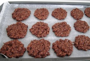 No bake chocolate oatmeal cookies formed to set on parchment paper