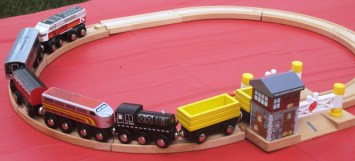 toy train trucks with little train set