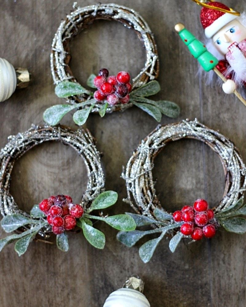 This Sparkly Christmas Mini Wreath is a simple Holiday DIY idea with tons of uses. Use it as a table decoration, tree ornament, or present topper. It all looks adorable! An easy craft for Christmas.