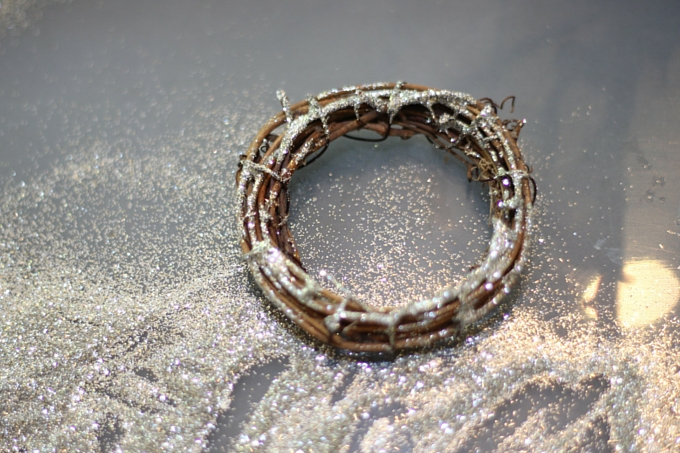 glitter being added to a wreath