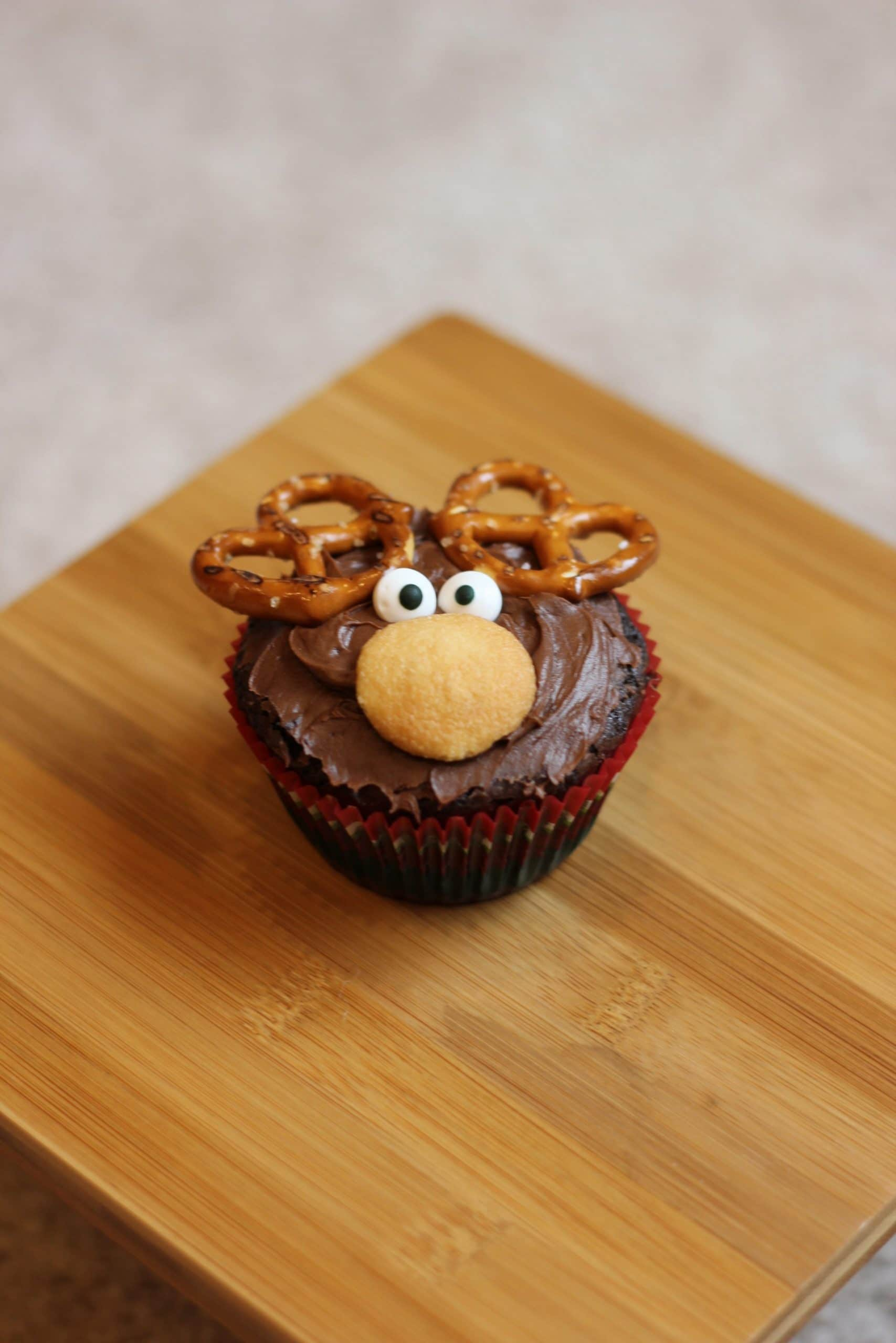 eye being added to Rudolph cupcake