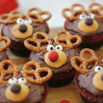 Reindeer cupcakes sitting on a white countertop.