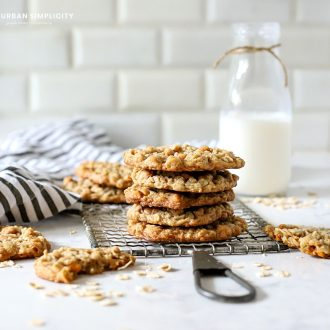 Oatmeal Scotchies stacked on a cooling rack.