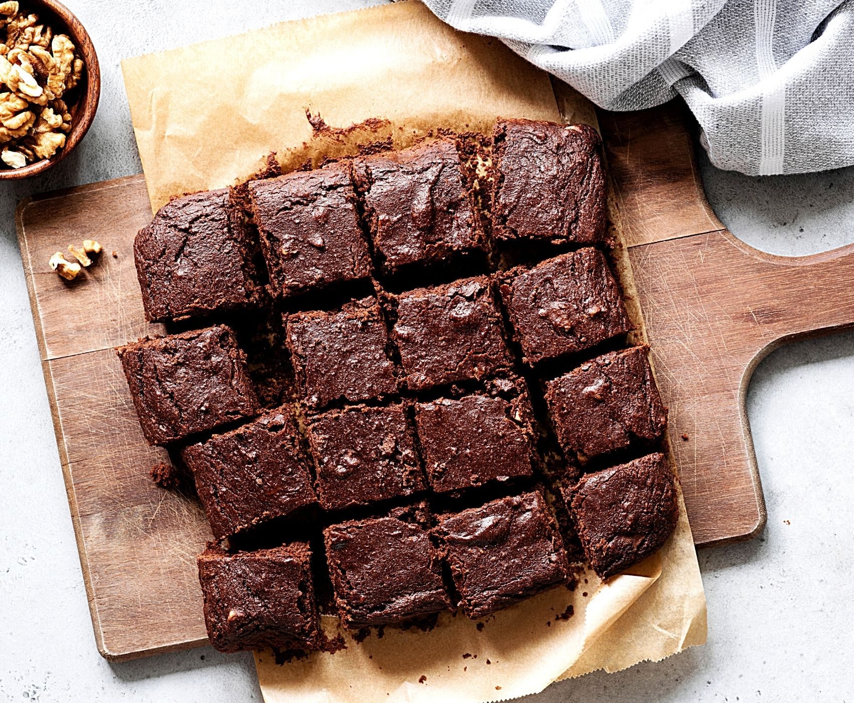 Dark chocolate brownies on a cutting board
