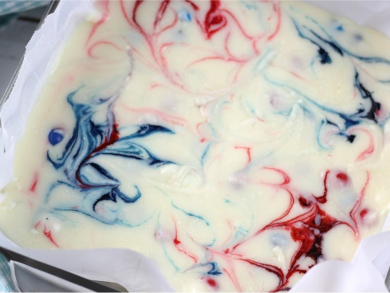 Skittles fudge with red and blue swirls.