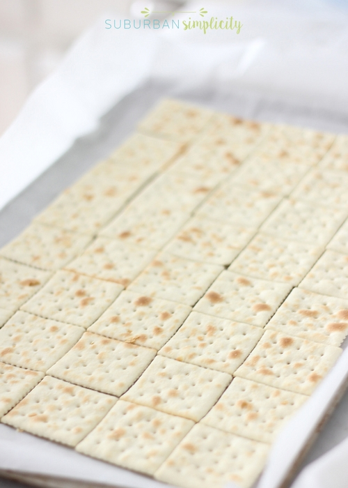 Saltine crackers on a baking pan.