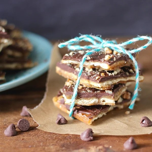 Saltine toffee sitting on a table with a bow tried around it.