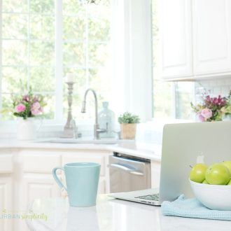 Kitchen with a computer and cup of tea on the counter