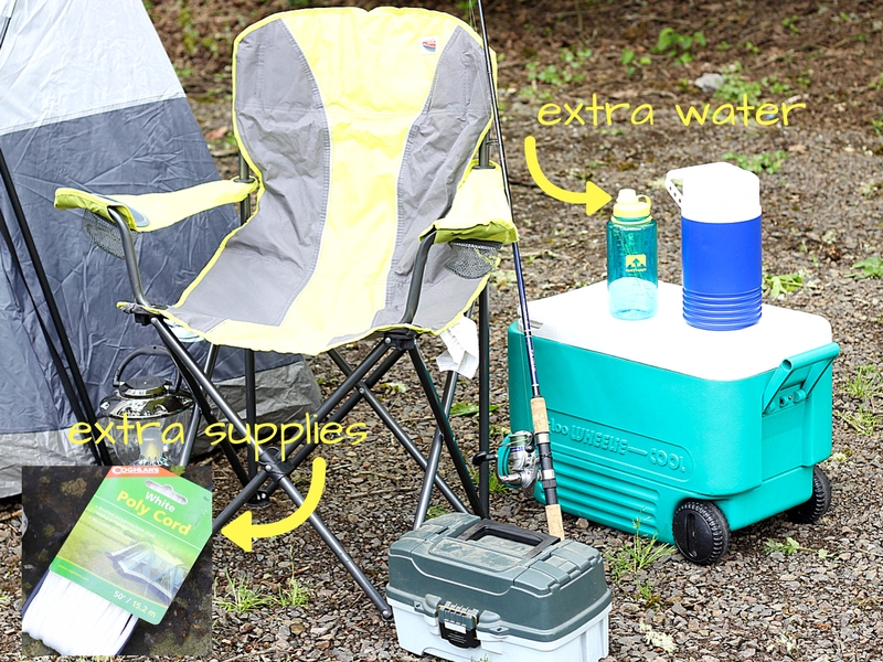 camping supplies like chairs, cooler and extra water