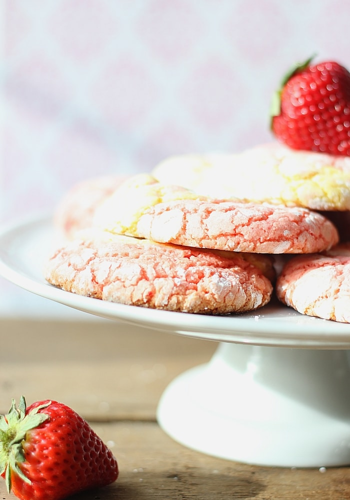 Stack of strawberry Lemonade Cookies on a cake stand.