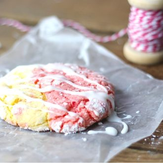 A strawberry lemonade cookie with icing on the counter