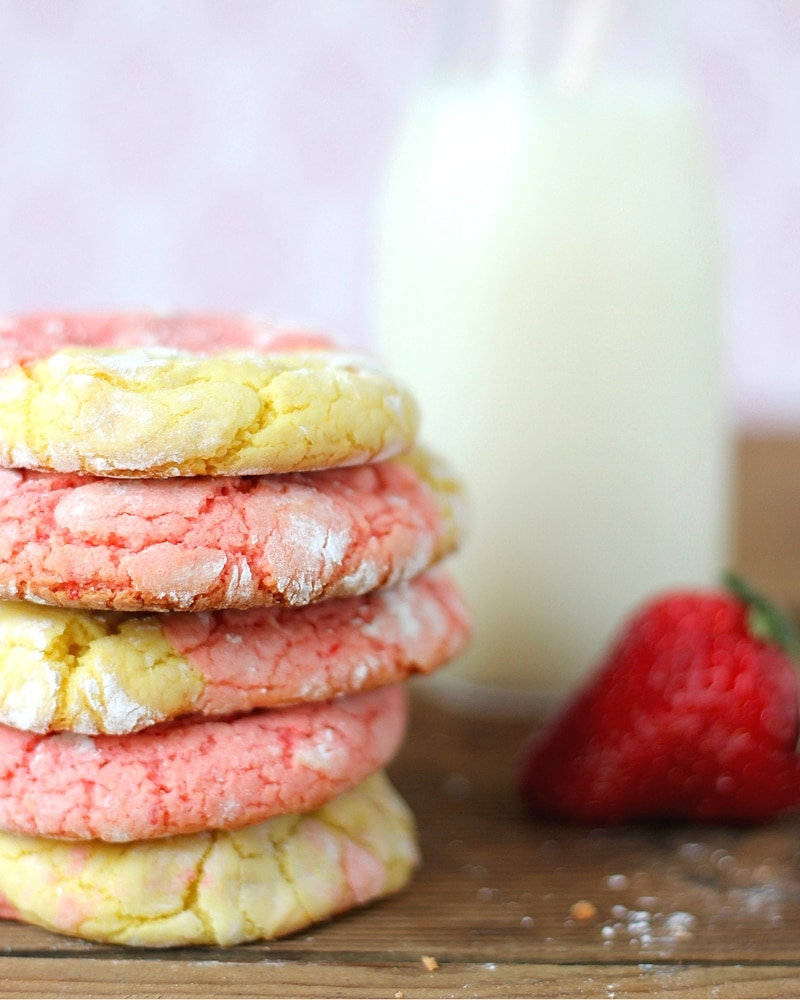 Strawberry Lemon cookies stacked next to milk