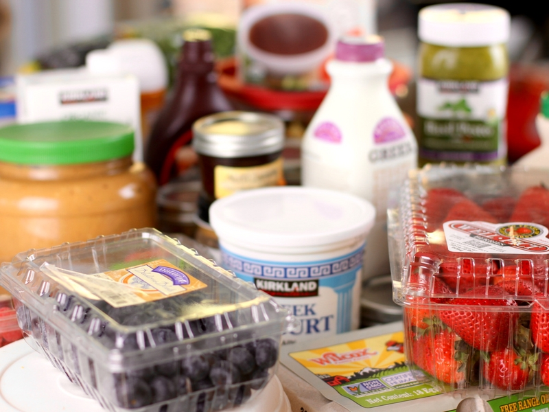 Food from fridge set on a counter.