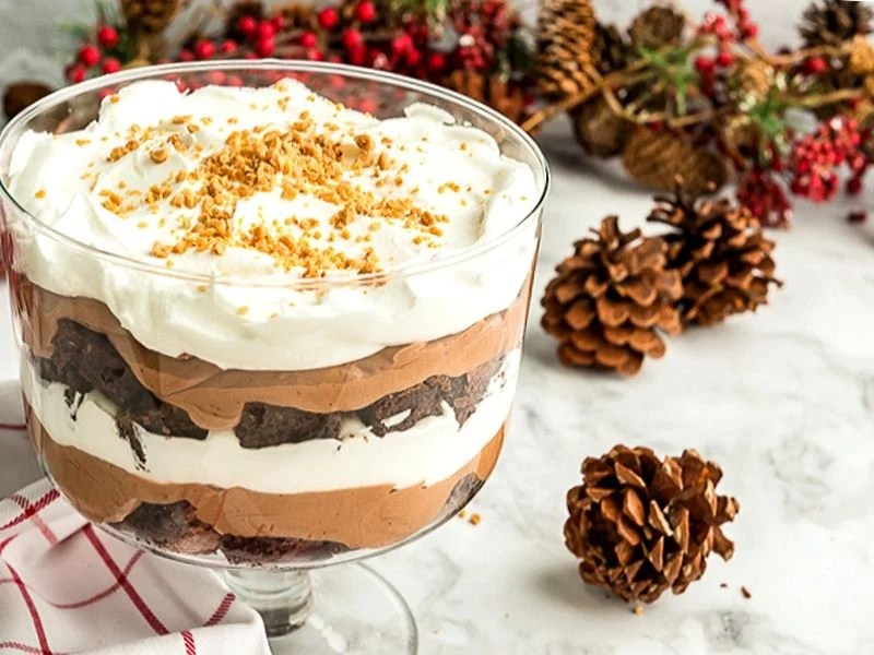 This easy Chocolate Trifle recipe is rich and decadent with layers of fudgy brownie, chocolate pudding and whipped cream. Plus, it's perfect to feed a crowd!