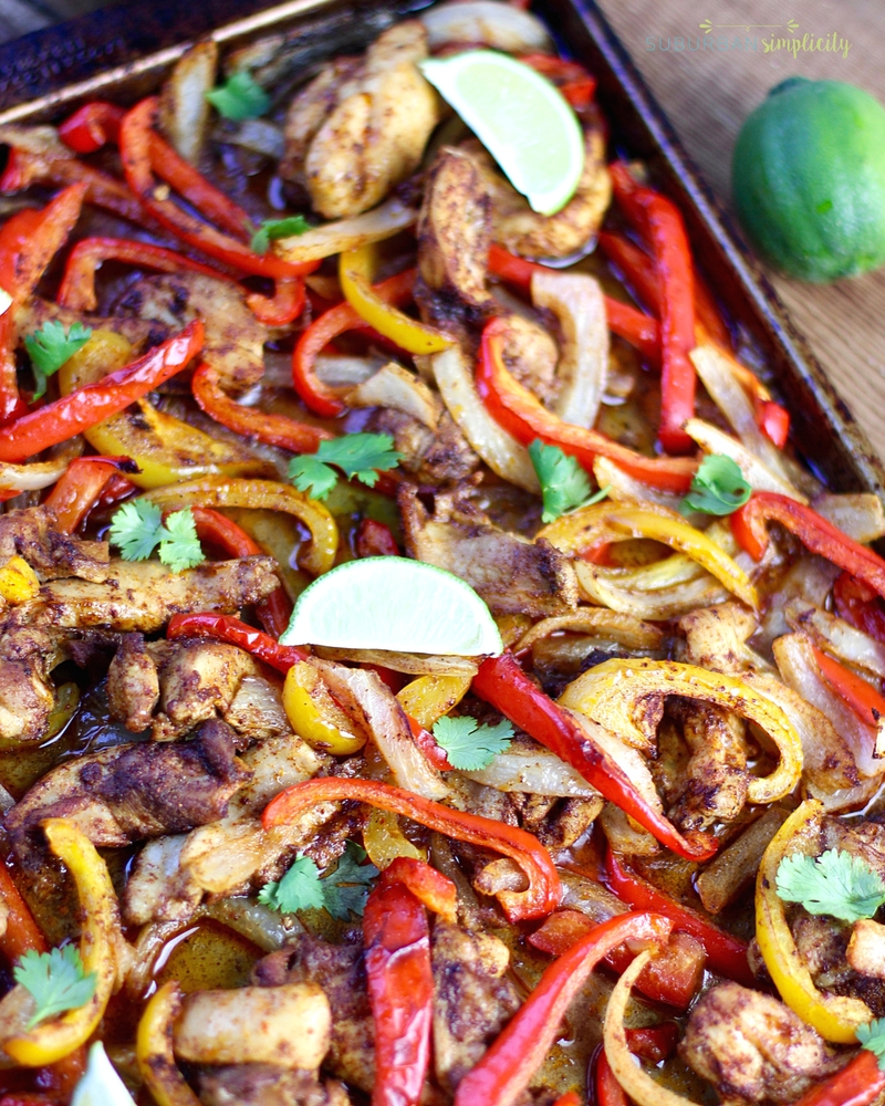 Baked chicken fajitas on a baking pan right out of the oven.