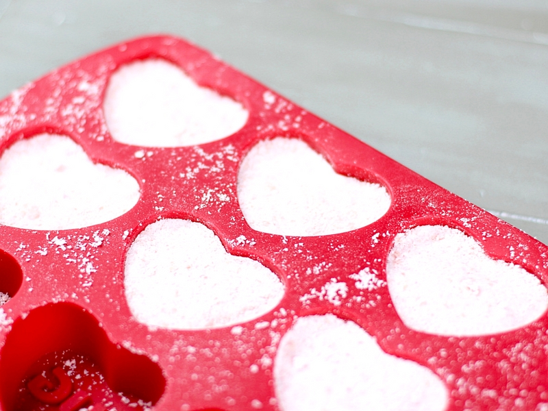 Red Heart shaped mold for making bath bombs.