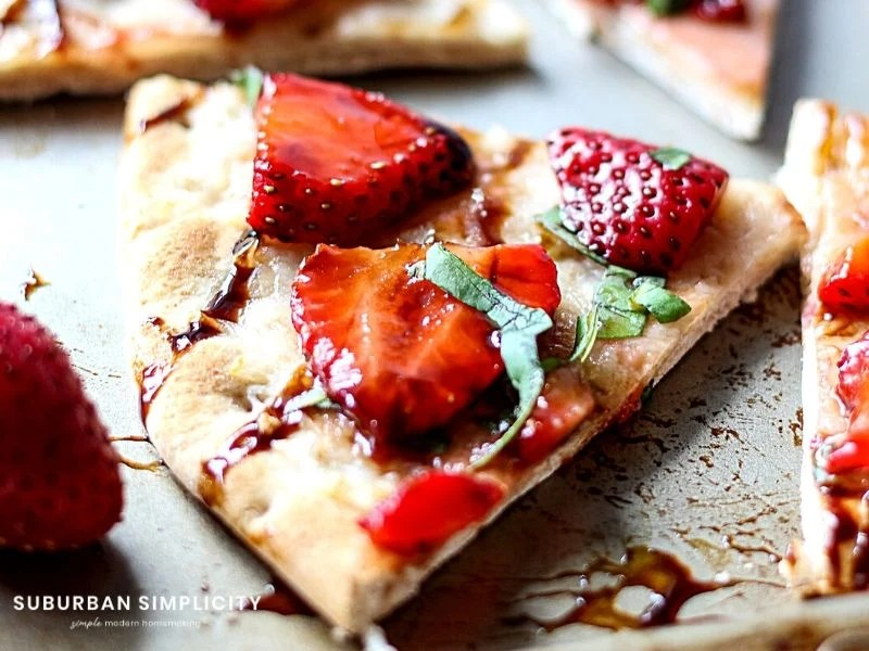 Strawberry Balsamic Flatbread is an easy recipe with lots of sweet and savory flavors. Fresh strawberries and basil on top crispy baked flatbread. The perfect summer appetizer, snack or meal!