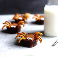 Halloween Brownie Spider with milk in the background.