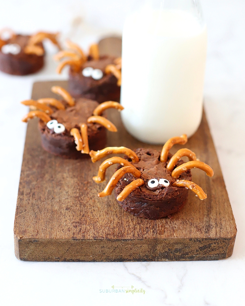 Halloween Spider recipe on a cutting board with milk.