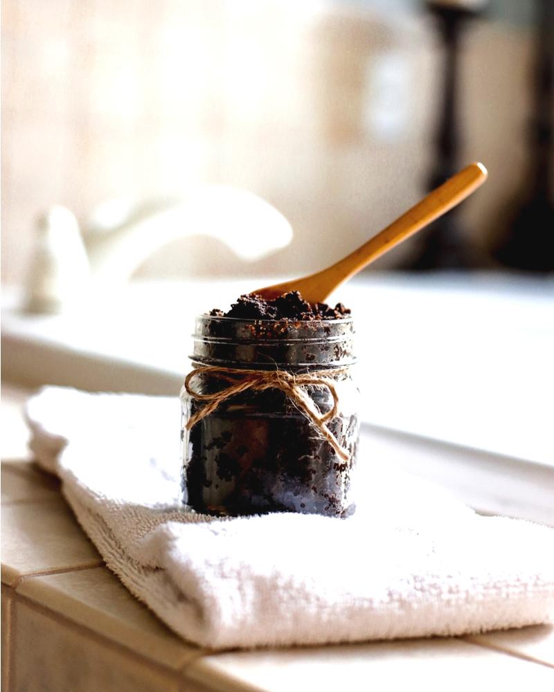 Coffee sugar scrub by a tub.