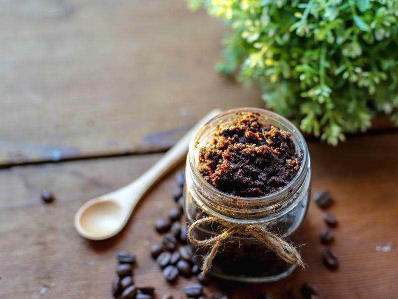 homemade sugar scrub with coffee bean next to it.