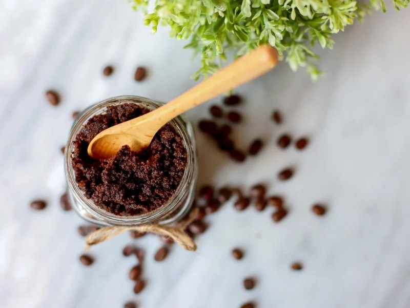 Coffee Sugar Scrub with wooden spoon sticking out.