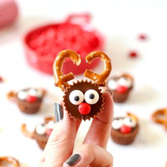 Fingers holding a Reese's Reindeer
