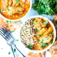 Instant Pot Butter Chicken in bowls with rice.