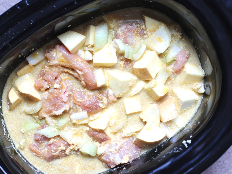 Slow Cooker Chicken Curry in a crock pot ready to cook.