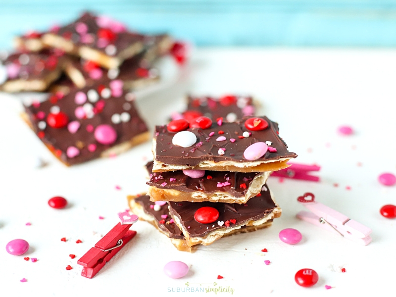 Valentine's Day Saltine Toffee Stacked together on a table.